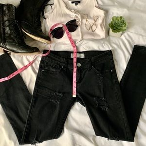 Low rise distressed black skinny jeans